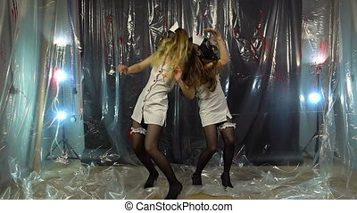 Two sexy dancing women in costumes - Footage of two dancing...