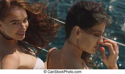 Two sexy girls enjoying summer on a luxury yacht