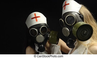Two sexy girls in gas mask