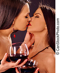 Two sexy lesbian women with red wine. - Two sexy lesbian...