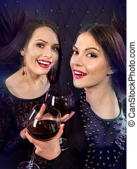 Two sexy lesbian women with red wine.