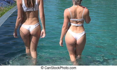 Two sexy women in the outdoor pool