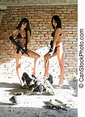 Two sexy women in underclothes with rifles and disarming...