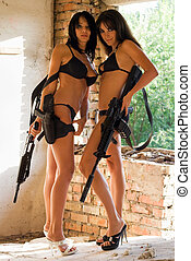 Two sexy women in underclothes with rifles