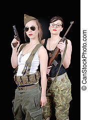 two sexy women posing in WW2 military uniform and weapons