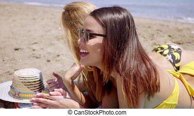 Two shapely young women in bikinis