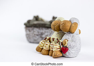 Two sheep figurines on a white background