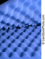 Two sheets of blue acoustic foam