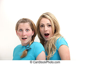 Two shocked and surprised women