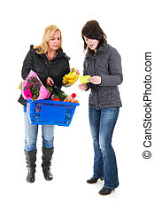 Two shopping woman in the supermarket