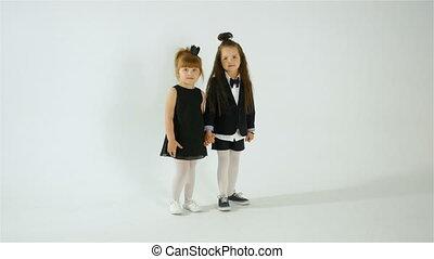Two Shy Preschool Girls Posing On Camera, Kid Fun Concept,...