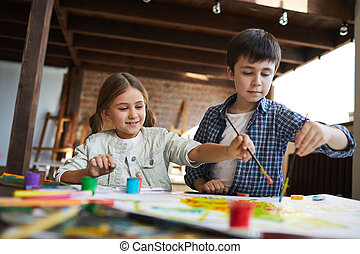 Two Siblings Painting Together