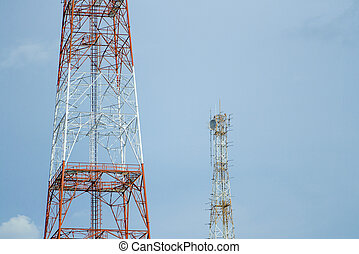 Two signal tower with blue sky.