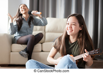Two sisters having fun in the living room