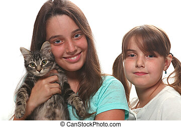 Two Sisters Holding Their Young Kitten