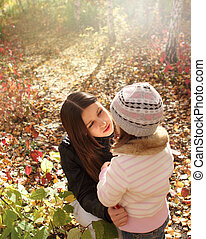 Two sisters in autumn forest