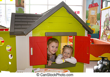 Two sisters in the playroom