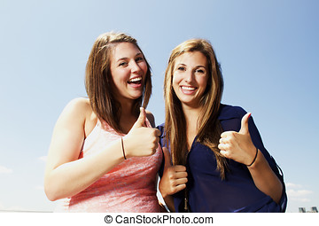 Two sisters interacting making peace sign