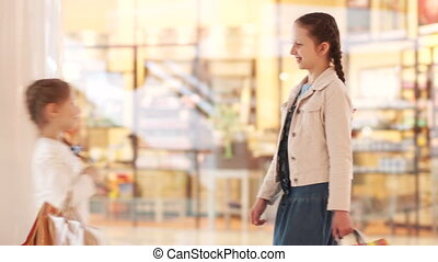 Two sisters met at the mall holding