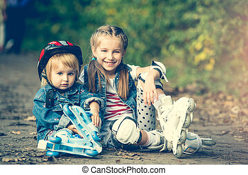 two sisters on roller skates