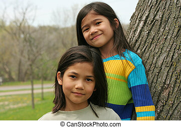 Two sisters outdoors