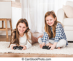 Two sisters playing games