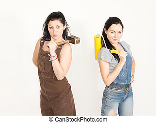Two sisters posing while renovating - Two attractive sisters...