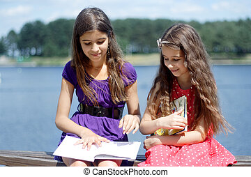 Two sisters reading poems