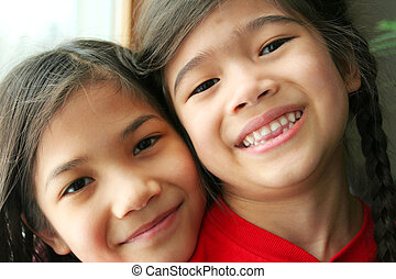 Two sisters smiling