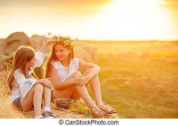 Two sisters spending time in field