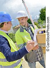 Two site surveyors on a job