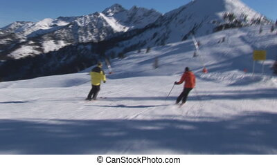 Two skiers overtaken by cameraman - Two skiers on...