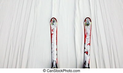 two skis ride on white slippery snow in winter, top view