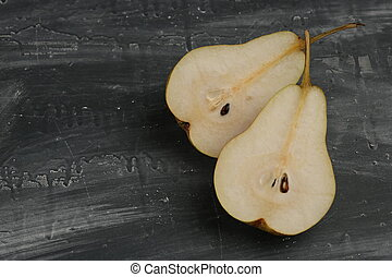 Two sliced pears on the table. Close up