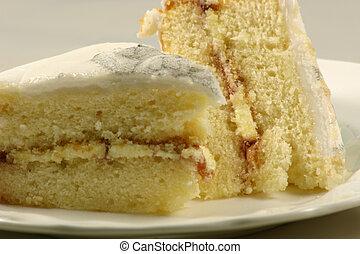 jam sponge cake - two slices of jam sponge cake