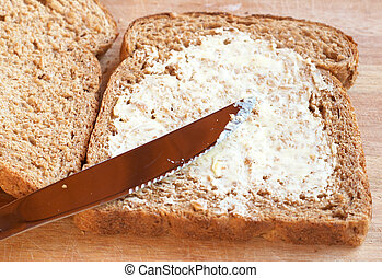 Two slices of Tasty healthy wholewheat bread with butter spread