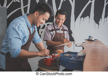 two small cafe owner busy working
