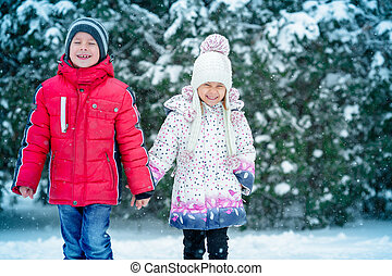 two small children  in the snow