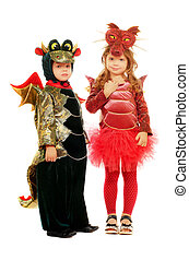 Two small children dressed as dragons. Isolated