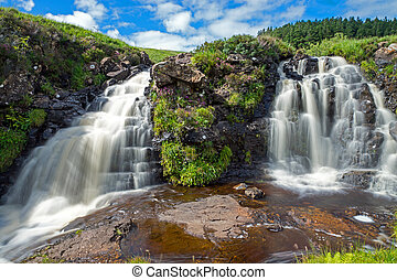 Two small waterfalls on the Isle of Skye in Scotland