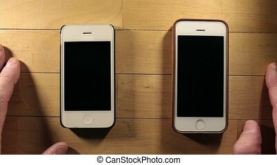 two smart phones expectation - Two smartphones waiting cal...