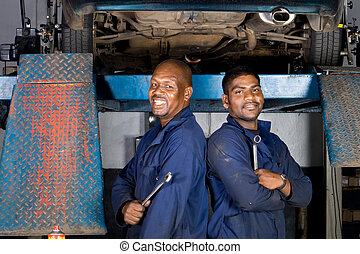 smiling african mechanics - two smiling african mechanics...