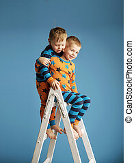 Two smiling brothers on the ladder