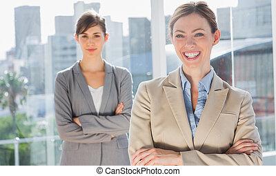 Two smiling businesswomen