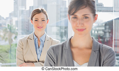 Two smiling businesswomen looking at camera