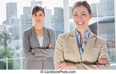 Two smiling businesswomen