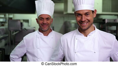 Two smiling chefs giving thumbs up to camera in a commercial...