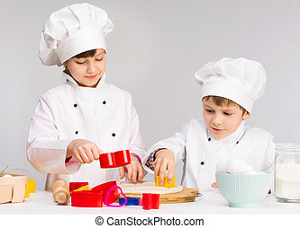 two smiling children in the kitchen
