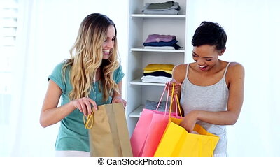 Two smiling friends shopping togeth