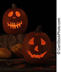 Night time of two smiling jack-o-lanterns against a black background